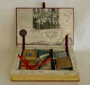 The inside of my altered book, a box with half a dozen miniature books demonstrating different techniques taught during the term and all made with original pages from the Story of Bethel College.